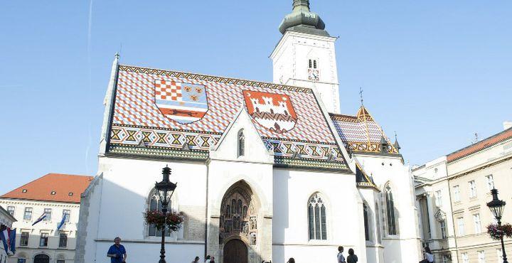 Ein Muss bei jedem Besuch der Hauptstadt Zagreb - Die Sankt Markus Kirche mit Ihrem unverwechselbaren Dach in Nationalfarben.